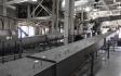 Dried sludge conveyor system